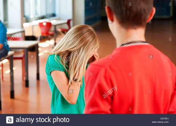 sad-girl-turning-away-from-her-boyfriend-CXT3FJ